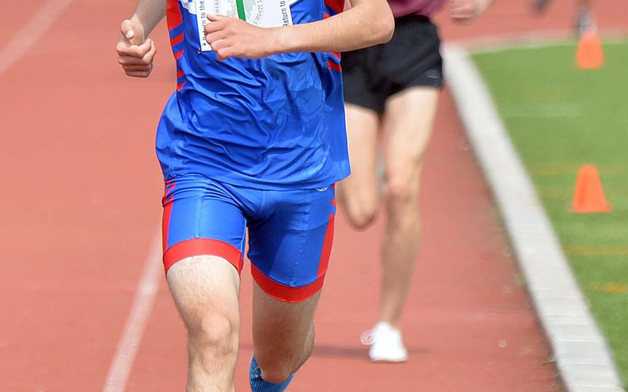 Ramstein's Dashiell Rogers powers to the finish line on his way to setting a new DODEA-Europe record in the 3,200-meter run with a time of 9 minutes, 49.21 seconds at the track and field championships in Kaiserslautern.