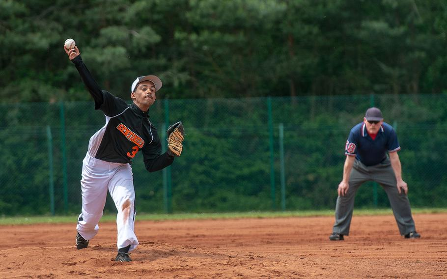 Spangdahlem's Eddie Dejesus throws a pitch during a game against Hohenfels on Day 2 of the boys Division II/III DODEA-Europe baseball championships, Friday, May 24, 2019.