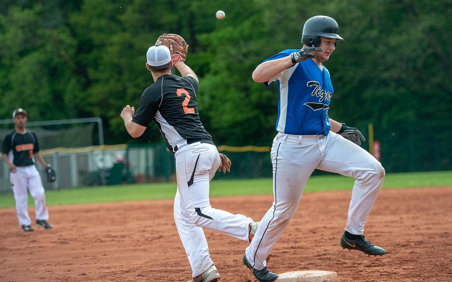 Hohenfels Liam Lankford beats a throw to first during a game against Spangdahlem on Day 2 of the boys Division II/III DODEA-Europe baseball championships, Friday, May 24, 2019.