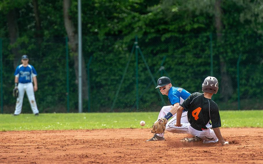 Spangdahlem's Carson Hicks steals second base during a game against Hohenfels on Day 2 of the boys Division II/III DODEA-Europe baseball championships, Friday, May 24, 2019.