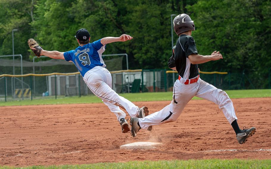 Spangdahlem's Carson Hicks beats a throw to first as Hohenfels' Julian Symkowick comes off the bag to get the ball during a game on Day 2 of the boys Division II/III DODEA-Europe baseball championships, Friday, May 24, 2019.