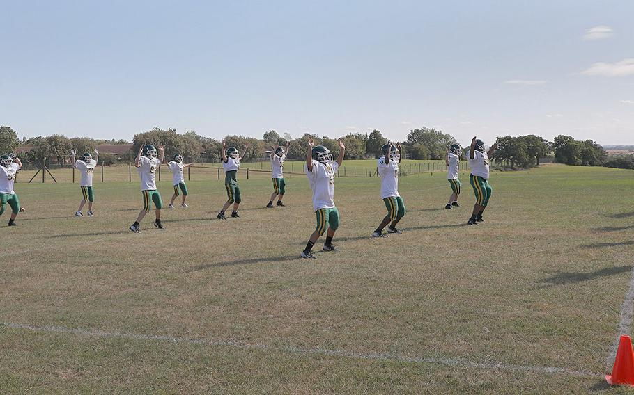 Members of the Alconbury Dragons warm up for practice Tuesday Sept. 3, 2019 on RAF Alconbury.