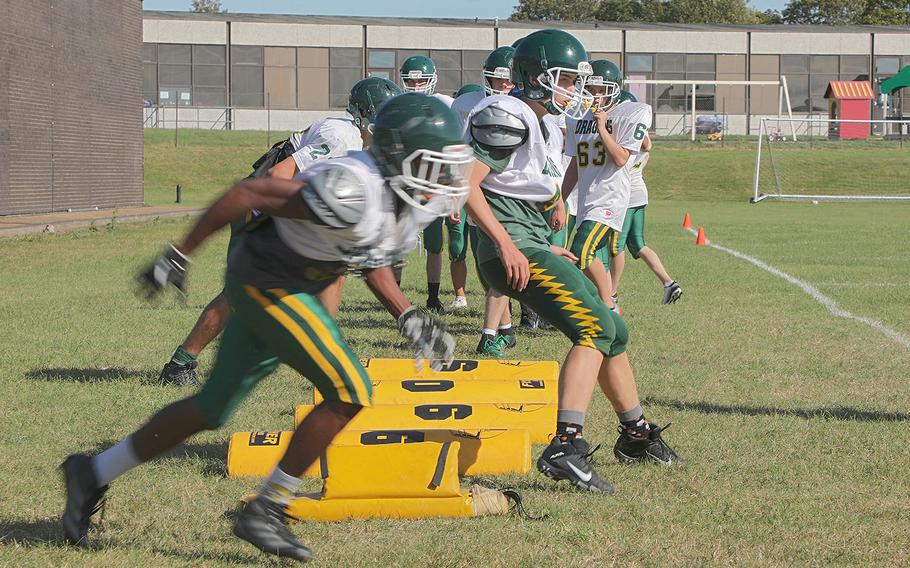 Alconbury Dragons football players conduct drills during practice Tuesday Sept. 3, 2019 on RAF Alconbury, England.