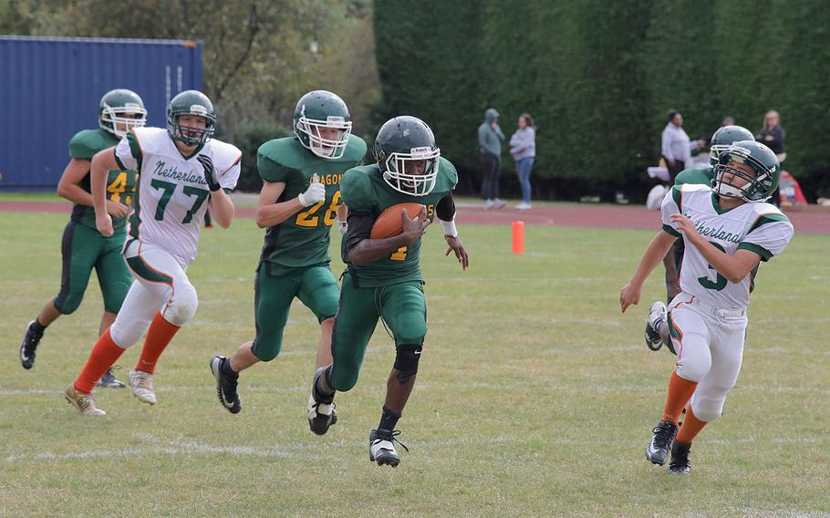 Alconbury's Tye Tre'von runs 80 yards in a kickoff return to get a touchdown in the begining of the third quarter to give the Dragons the lead 19-18 at RAF Alconbury, England, on Saturday, Sept. 7, 2019.