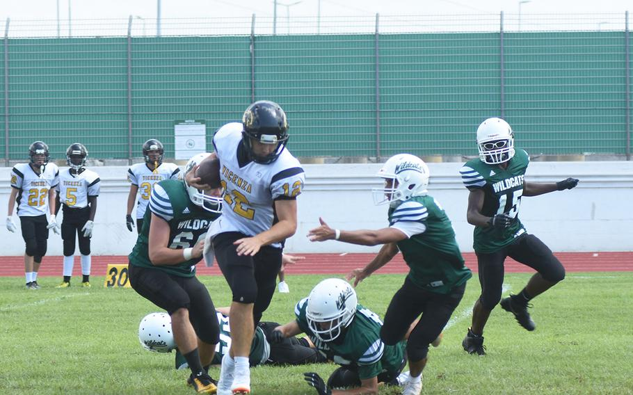 Cougars quarterback Lucas Ridgely breaks several tackles from smaller Wildcats on Saturday, Sept. 7, 2019 at Naples Middle High School. Ridgely proved more effective at running than passing -- throwing five interceptions -- but despite his efforts, the Wildcats beat the Cougars 26-6.