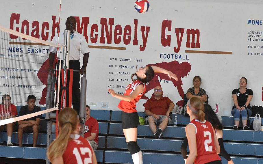 American Overseas School of Rome's Sophia Notalianni goes up for a spike in a match against Rota on Saturday, Sept. 14, 2019.