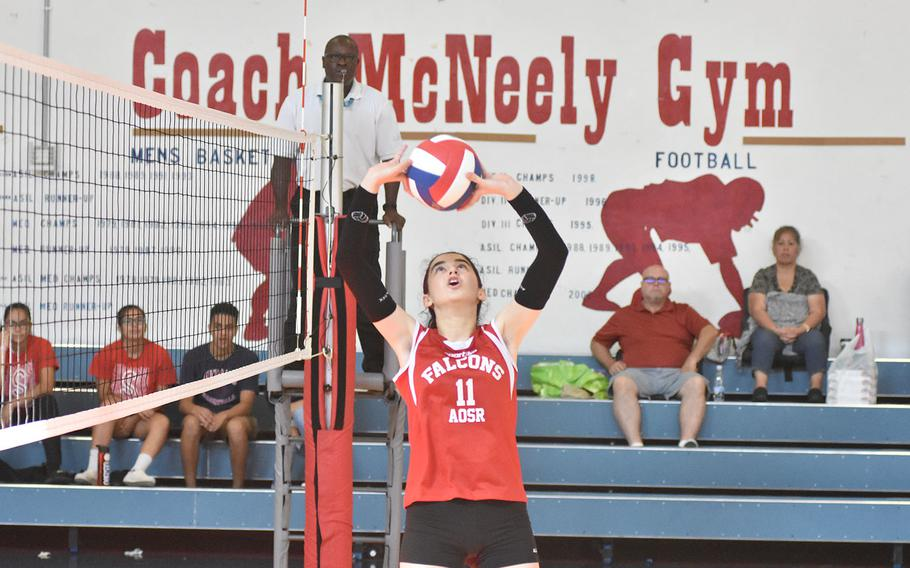 American Overseas School of Rome's Giorgia Santulli Sanzo sets the ball to a teammate Saturday, Sept. 14, 2019, in a match against Rota. The Falsons prevailed in four sets.