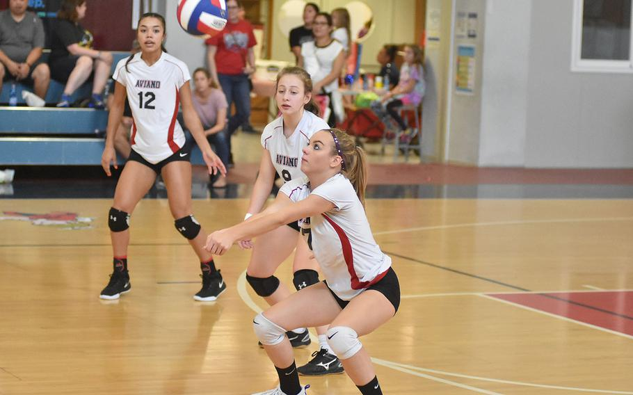 Aviano's Ashley Woodruff gets set for a pass in the Saints' three-set victory over Rota on Saturday, Sept. 14, 2019.