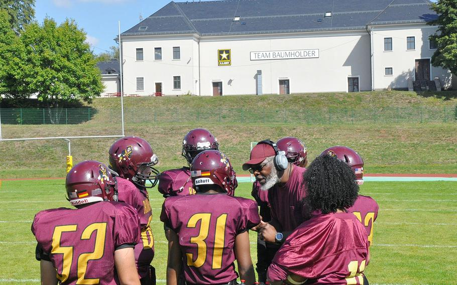 Baumholder coach Phillip Loyd addresses his team during a timeout in the Bucs' 21-12 loss to Hohenfels on Saturday, Sept. 14, 2019, at Baumholder, Germany.