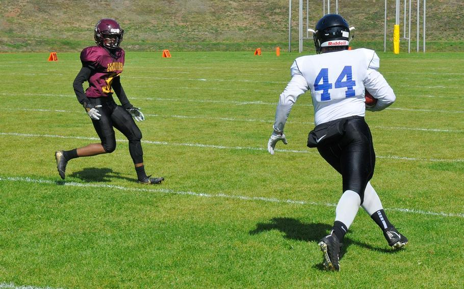 Hohenfels runner Liam Lankford sizes up the Baumholder defense in his team's 21-12 victory  Saturday, Sept. 14, 2019, at Baumholder, Germany.