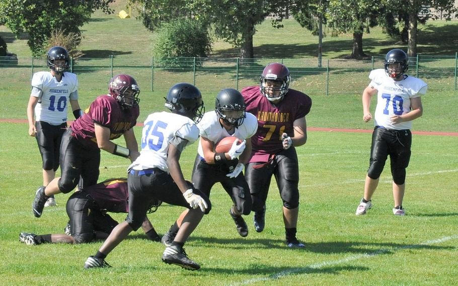 Hohenfels' Jared Wiggins carries the ball against Baumholder in Hohenfels 21-12 victory Saturday, Sept. 14, 2019, at Baumholder, Germany.