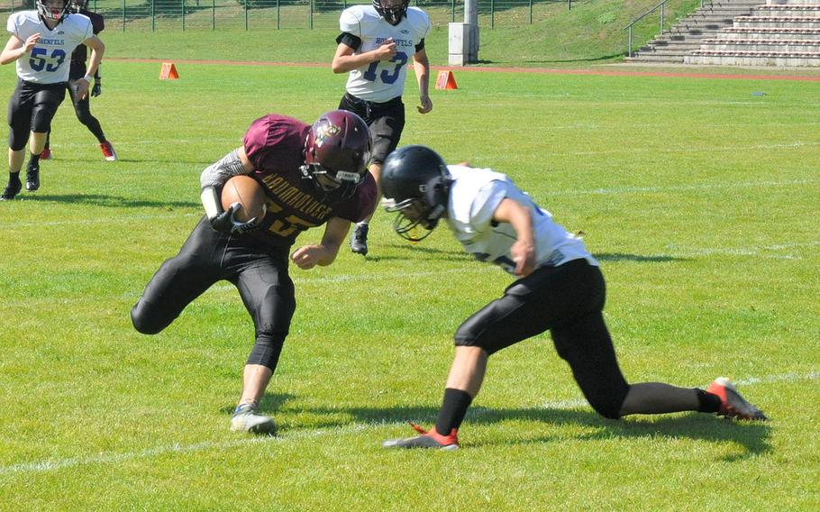 Baumholder ball carrier Wilbur Turgeon collides with a Hohenfels defender in Hohenfels' 21-12 victory Saturday, Sept. 14, 2019, at Baumholder, Germany.