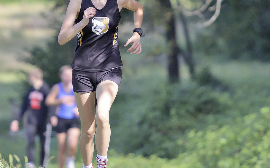 Kaley Smith of Vicenza High School crosses the finish line in third place during the cross country meet held at San Floriano Parco Rurale, Polcenigo, Italy, Saturday, Sept. 14, 2019.