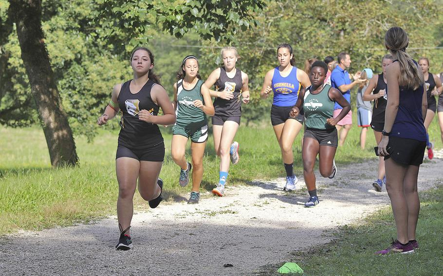 Girls from five Department of Defense Education Activity schools take off during the beginning of the cross country meet held at San Floriano Parco Rurale's running course, Polcenigo, Italy, Sept. 14, 2019. A total of 33 girls started the race but only 30 finished due to some of them sustaining ankle injuries during the race.