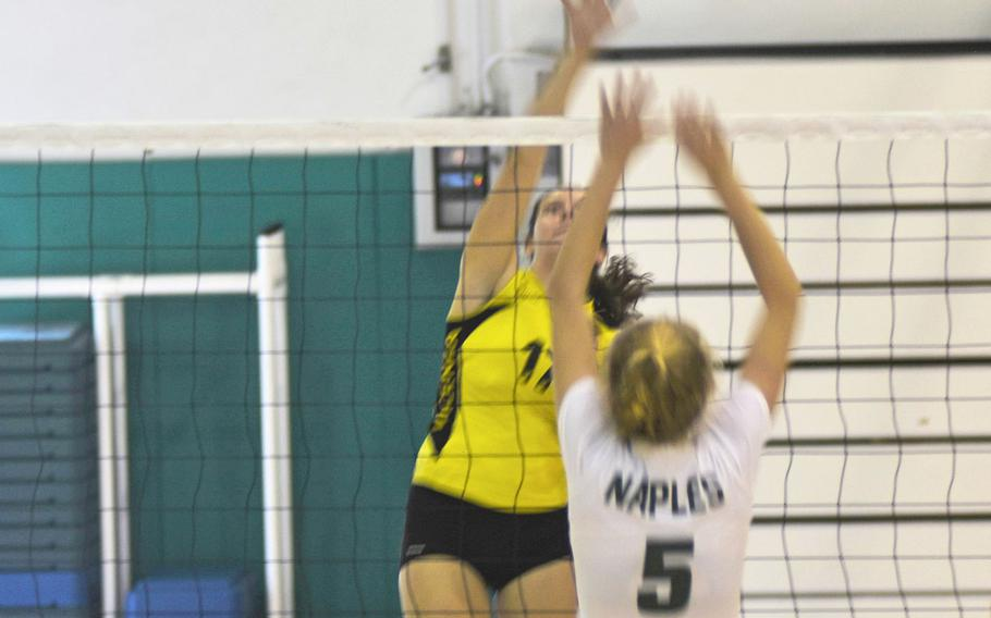 Cougar Londyn Wilson prepares to strike the ball while Wildcat Roxanne Sasse defends. Naples beat Vicenza in a five-set match on Saturday Sept. 14, 2019 at Naples Middle High School.