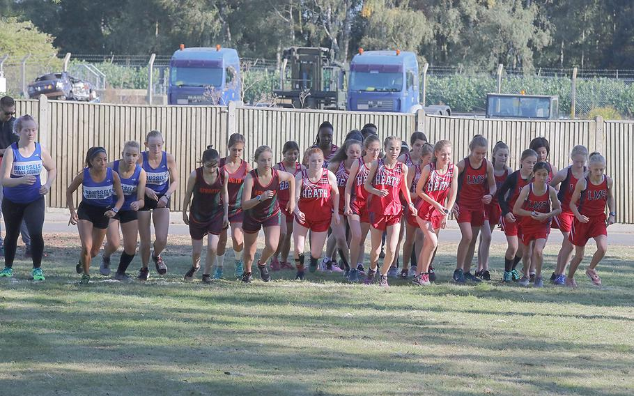 The girls from the AFNORTH, Brussels and Lakenheath cross country teams start a 5-kilometer competition at RAF Lakenheath on Saturday, Sept. 21, 2019