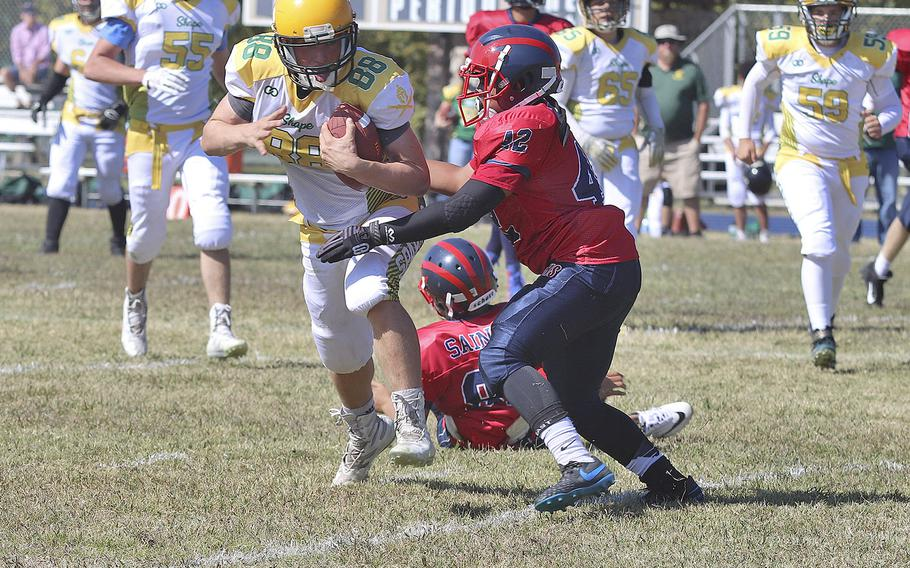 Sam Hennig carries the ball for SHAPE in a 52-16 loss to Aviano on Saturday, Sept. 21, 2019.