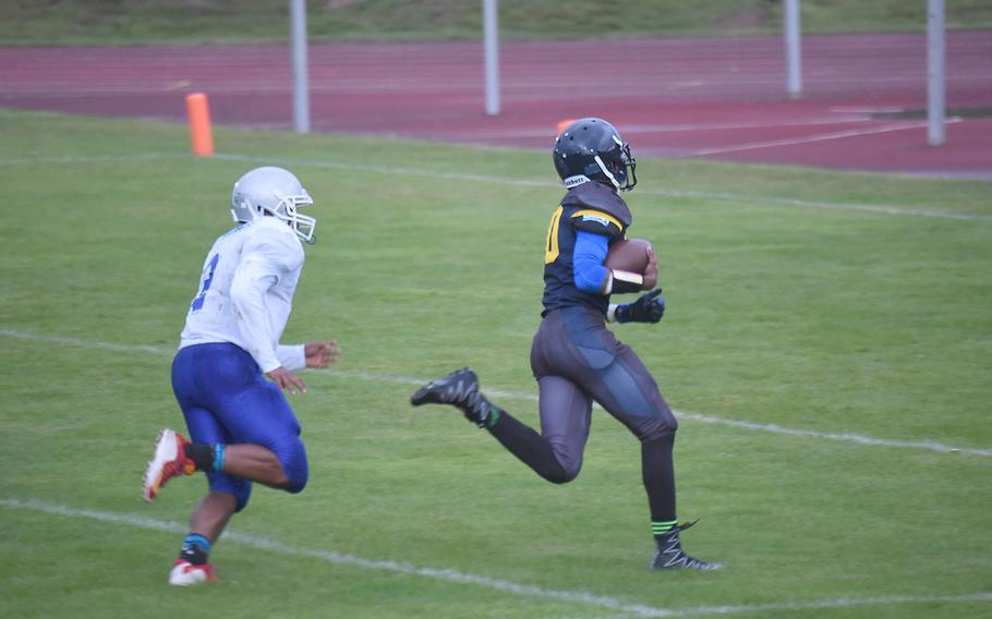 Ansbach'sJosiah Jackson pulls ahead of Brussels' Kalani Villa, in a game against Brussels, at Ansbach, Germany, Friday, Sept. 27, 2019.
