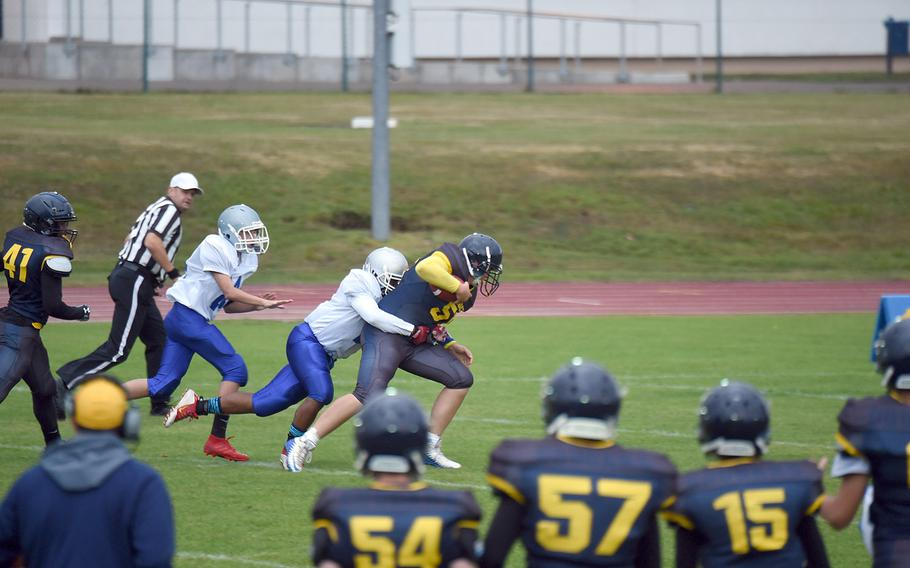 Ansbach's Caison Duplessie trudges through several Brigands in a game against Brussels, at Ansbach, Germany, Friday, Sept. 27, 2019.