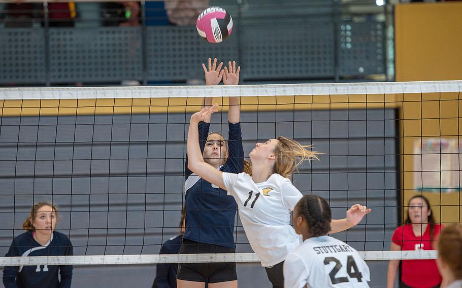 Lakenheath's Jordin Dupre goes up to block a shot from Stuttgart's Lindsey Sharp during a volleyball game at the South Side Fitness Center, Ramstein Air Base, Germany, Saturday, Sept.  28, 2019.