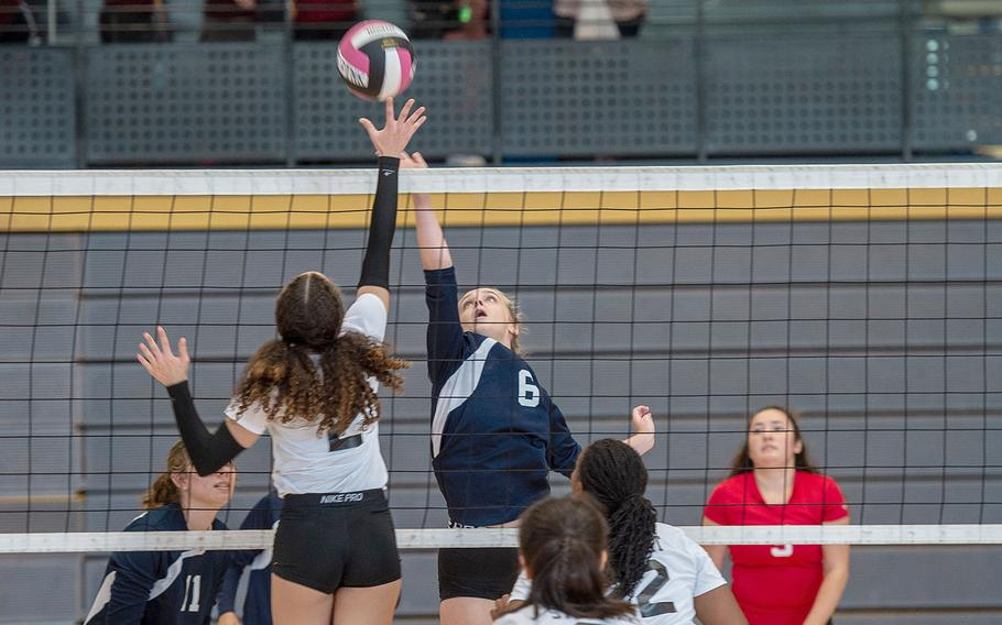 Lakenheath's Karlee Brennan and Stuttgart's Gabi Broadus go up for the ball during a volleyball game at the South Side Fitness Center, Ramstein Air Base, Germany, Saturday, Sept.  28, 2019.