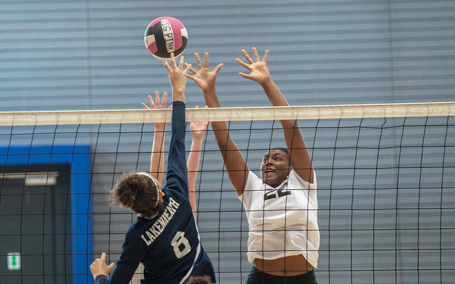 Stuttgart's Skye DaSilva goes up for a block during a game between Stuttgart and Lakenheath at the South Side Fitness Center, Ramstein Air Base, Germany, Saturday, Sept.  28, 2019.