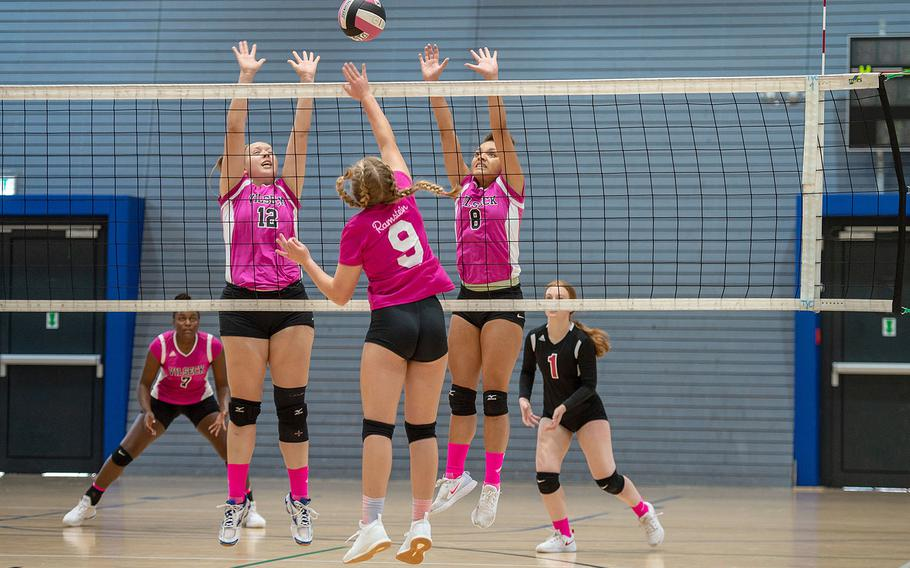 Rebekah Heckert, left, and Kayla Silva go up for a block during a game between Ramstein and Vilseck at the South Side Fitness Center, Ramstein Air Base, Germany, Saturday, Sept.  28, 2019.
