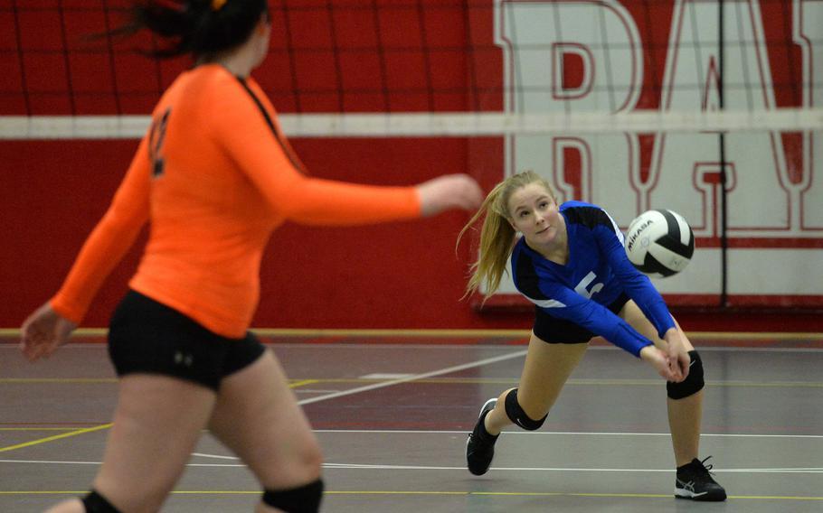 Brussels' Olivia Bauer dives to make a return on a Spangdahlem serve in a Division III semifinal against Brussels at the DODEA-Europe volleyball finals in Kaiserslautern, Friday, Nov. 1, 2019. Brussels lost the tight match 25-22, 22-25, 25-19, 21-25, 16-14. At left is Spangdahlem's Molly Branson.