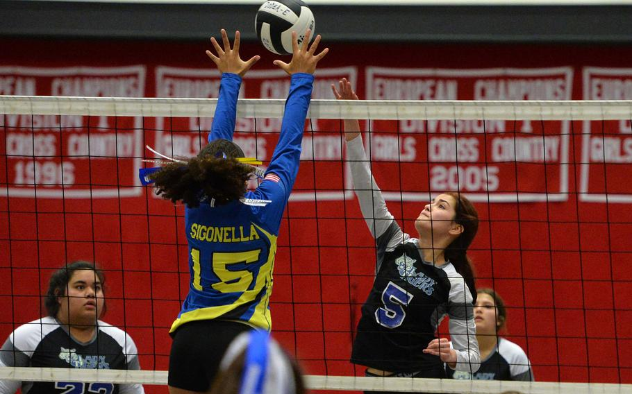 Sigonella's Averi Chandler tries to block a shot by Hohnefels' Jasmine Ritchey in a Division III semifinal at the DODEA-Europe volleyball finals in Kaiserslautern, Friday, Nov. 1, 2019. Sigonella defeated Hohenfels 25-22, 25-27, 25-11, 25-22 to advance to Saturday's final against Spangdahlem.