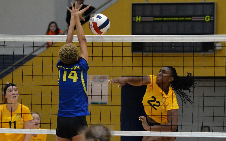 Stuttgart's Skye DaSilva Mathis hits the ball across the net as Wiesbaden's Alynna Palacios tries to block in a Division I semifinal at the DODEA-Europe volleyball finals in Ramstein, Friday, Nov. 1, 2019. Stuttgart beat Wiesbaden 21-25, 25-21,16-25, 25-14, 15-7 and will face Ramstein in Saturday's final.