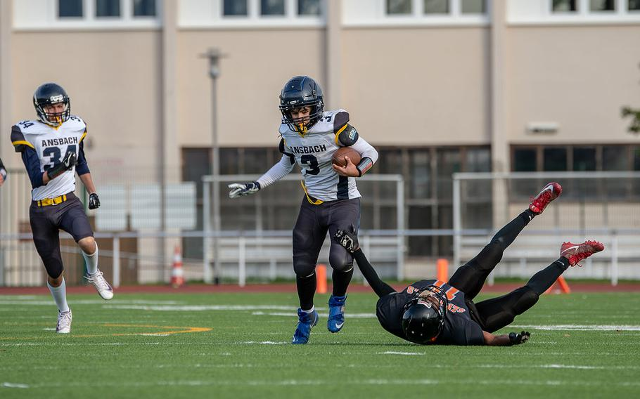 Ansbach's Keoni Ulloa-Galindo breaks a tackle before scoring against Spangdahlem during the Division III Football Championship game at Kaiserslautern High School, Germany, Saturday, Nov. 2, 2019. Spangdahlem won the game 39-26.