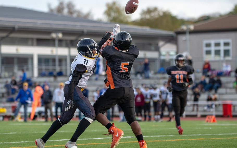 Ansbach's Josiah Quinlan breaks up a fourth-down pass during a game against Spangdahlem for the Division III Football Championship at Kaiserslautern High School, Germany, Saturday, Nov. 2, 2019. Spangdahlem won the game 39-26.