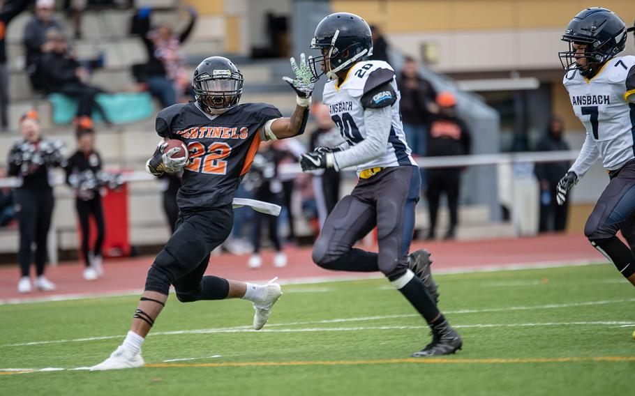 Spangdahlem's Deon Montgomery tries to stiff-arm Ansbach's Josiah Jackson before he is pushed out of bounds during the Division III Football Championship game at Kaiserslautern High School, Germany, Saturday, Nov. 2, 2019. Spangdahlem won the game 39-26.