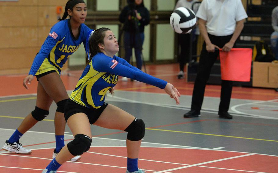 Sigonella's Jessenia Diaz bumps the ball as teammate D'Anna Holland watches in the Division III final against Spangdahlem at the DODEA-Europe volleyball championships in Kaiserslautern, Germany, Saturday, Nov. 2, 2019. Spangdahlem won 22-25, 25-12, 25-20, 26-24.