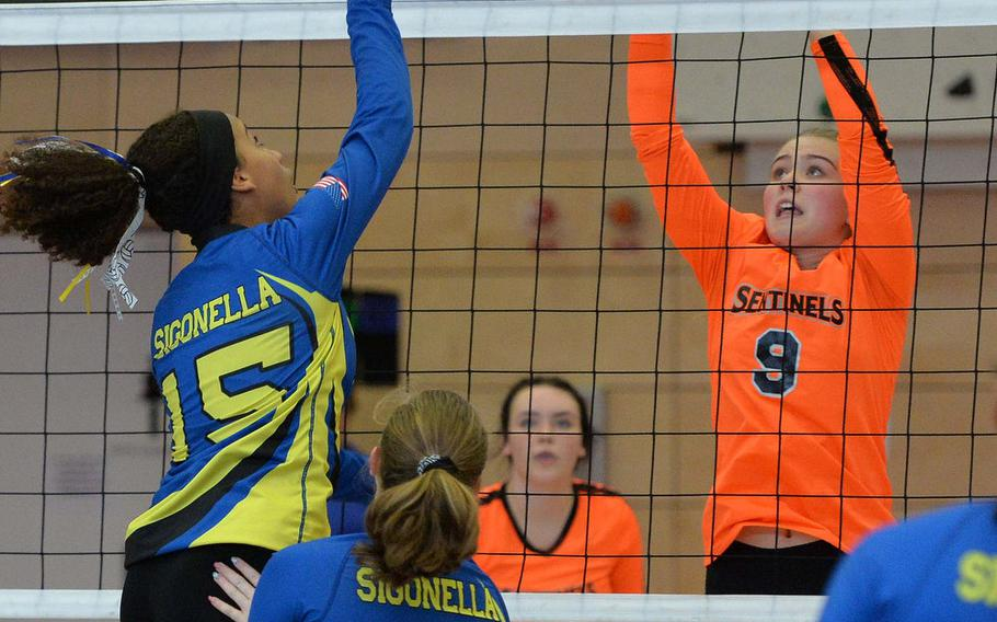 Sigonella's Averi Chandler returns the ball against Spangdahlem's Chloe Price as their teammates Kylee Fall, foreground, and Molly Branson watch. Spangdahlem defeated Sigonella in the Division III final at the DODEA-Europe volleyball championships in Kaiserslautern, Germany, Saturday, Nov. 2, 2019, 22-25, 25-12, 25-20, 26-24.