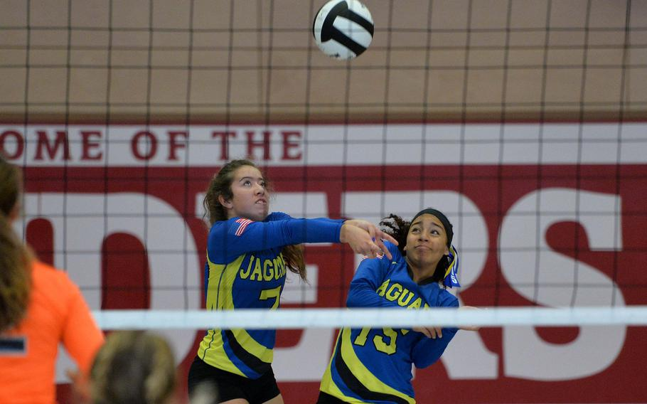 Sigonella's Averi Chandler, right, gets out of the way as teammate Emmy McCarthy receives a Spangdahlem serve in the Division III final at the DoDEA-Europe volleyball championships in Kaiserslautern, Germany, Saturday, Nov. 2, 2019. Spangdahlem took the title, winning 22-25, 25-12, 25-20, 26-24.