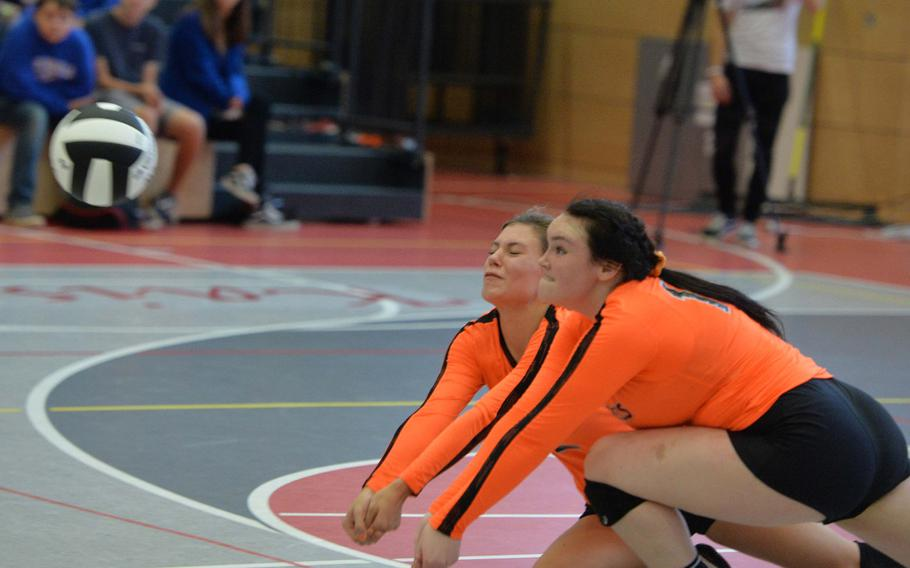 Spangdahlem's Keena Teahon, left, and Molly Branson team-up to dig out a Sigonella serve in the Division III final at the DODEA-Europe volleyball championships in Kaiserslautern, Germany, Saturday, Nov. 2, 2019. Spangdahlem won 22-25, 25-12, 25-20, 26-24.