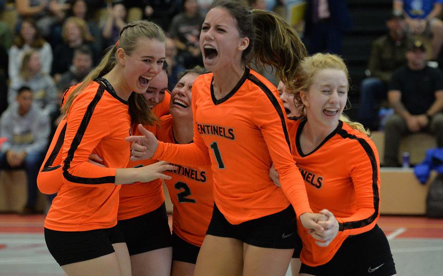 The Spangdahlem Sentinels celebrate their DODEA-Europe Division III title after defeating Sigonella 22-25, 25-12, 25-20, 26-24, in Kaiserslautern, Saturday, Nov. 2, 2019.