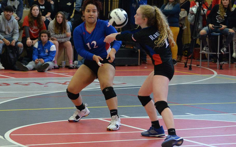 Ramstein libero Lydia Coddington receives a Stuttgart serve as teammate Joselyn Rosado watches. Ramstein beat Stuttgart 21-25, 25-21, 22-25, 25-23, 20-18 in the Division I final at the DODEA-Europe volleyball championships in Kaiserslautern, Saturday, Nov. 2, 2019.