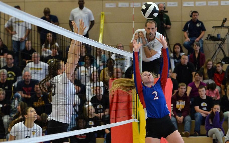Ramstein's Isabella Coddington hits the ball back across the net as Stuttgart's Rebekah Johnson defends in the Division I final at the DODEA-Europe volleyball championships in Kaiserslautern, Saturday, Nov. 2, 2019. Ramstein beat Stuttgart 21-25, 25-21, 22-25, 25-23, 20-18.