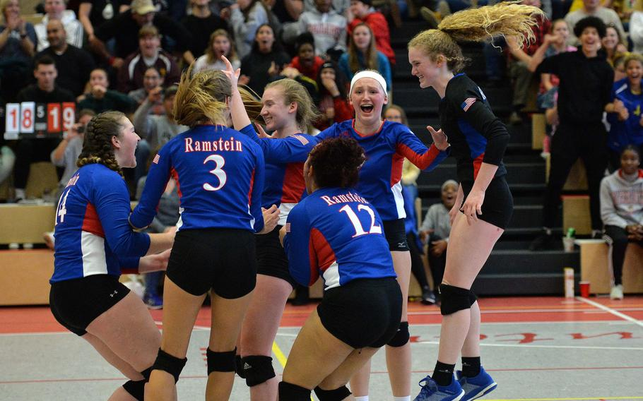 The Ramstein Royals celebrate their 21-25, 25-21, 22-25, 25-23, 20-18 victory over defending champion Stuttgart in the Division I final at the DODEA-Europe volleyball championships in Kaiserslautern, Saturday, Nov. 2, 2019.