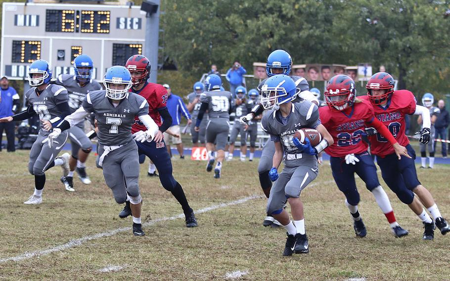 Rota Admirals kick returner Blake Wall tries to get away from Aviano Saints defenders during Saturday's DODEA-Europe Division II Championship game held at Aviano.