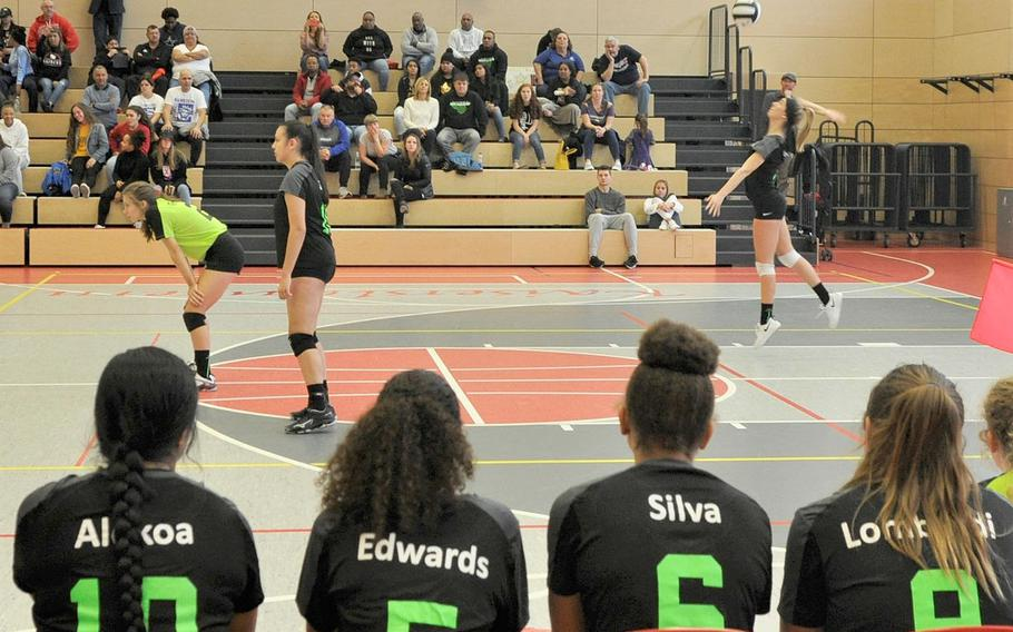 Stuttgart's Lindsey Sharp launches a serve in front of her Black team's bench in the 2019 DODEA-Europe volleyball all-star matches Saturday at Kaiserslautern High School in Kaiserslautern, Germany.