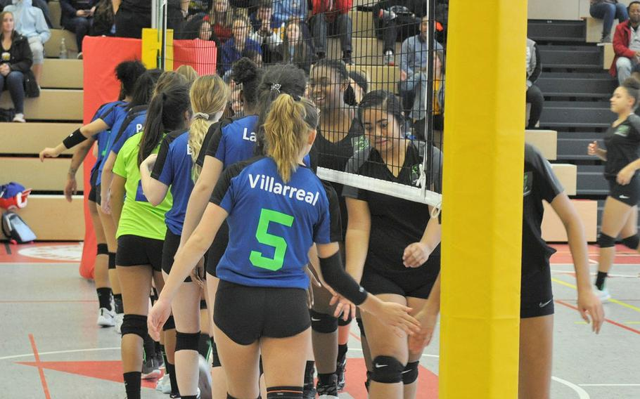 The Blue and Black teams slap hands at the start of the 2019 DODEA-Europe volleyball all-star matches Saturday at Kaiserslautern High School in Kaiserslautern, Germany.