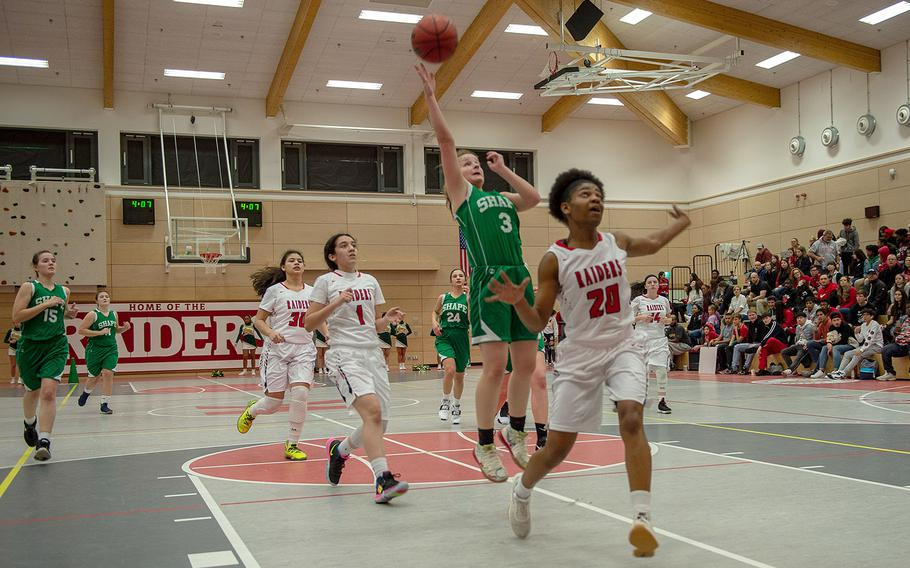 SHAPE's Gabi Shultz goes up for a lay-up during a basketball game between Shape and Kaiserslautern at Kaiserslautern High School, Germany, Friday, Dec. 6, 2019. SHAPE won the game 45-40.