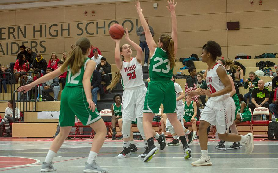 Kaiserslautern's Eden Wheeler takes a shot during a basketball game between SHAPE and Kaiserslautern at Kaiserslautern High School, Germany, Friday, Dec. 6, 2019. SHAPE won the game 45-40.