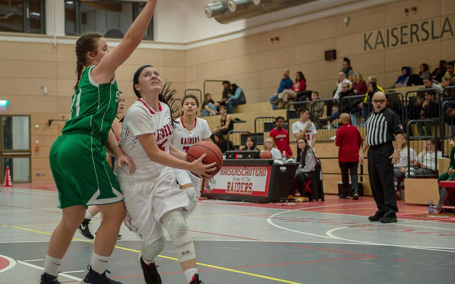 Kaiserslautern's Rebecca Moon looks to take a shot during a basketball game between SHAPE and Kaiserslautern at Kaiserslautern High School, Germany, Friday, Dec. 6, 2019. SHAPE won the game 45-40.