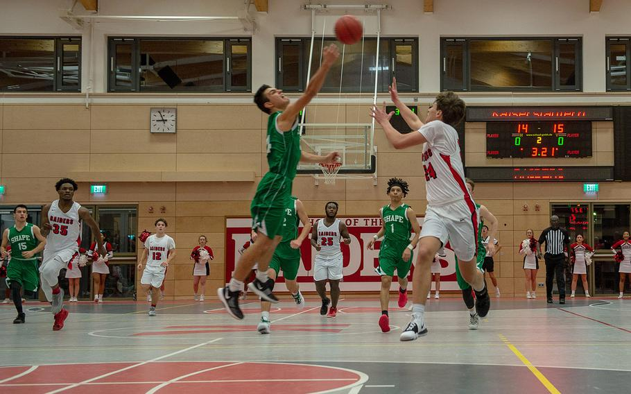 Players battle for the ball during a basketball game between SHAPE and Kaiserslautern at Kaiserslautern High School, Germany, Friday, Dec. 6, 2019. Kaiserslautern won the game 56-32.
