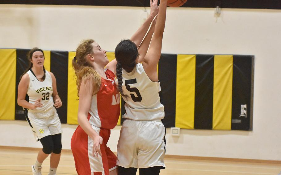 American Overseas School of Rome's Evan Park tries to block the shot of Vicenza's Bridget Craig but gets called for the foul in the Cougars' 41-33 victory on Friday, Dec. 6, 2019.