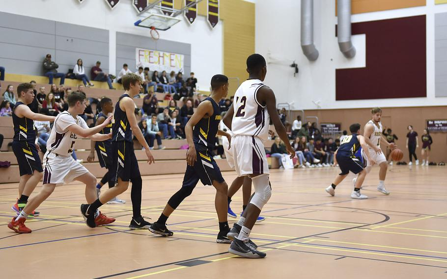The Vilseck Falcons and Ansbach Courgars battle it out during Saturday's game held at Vilseck. The Vilseck Falcons soared past the Ansbach Cougars in both girls and boys varsity basketball games.